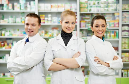 three pharmacists smiling in the pharmacy