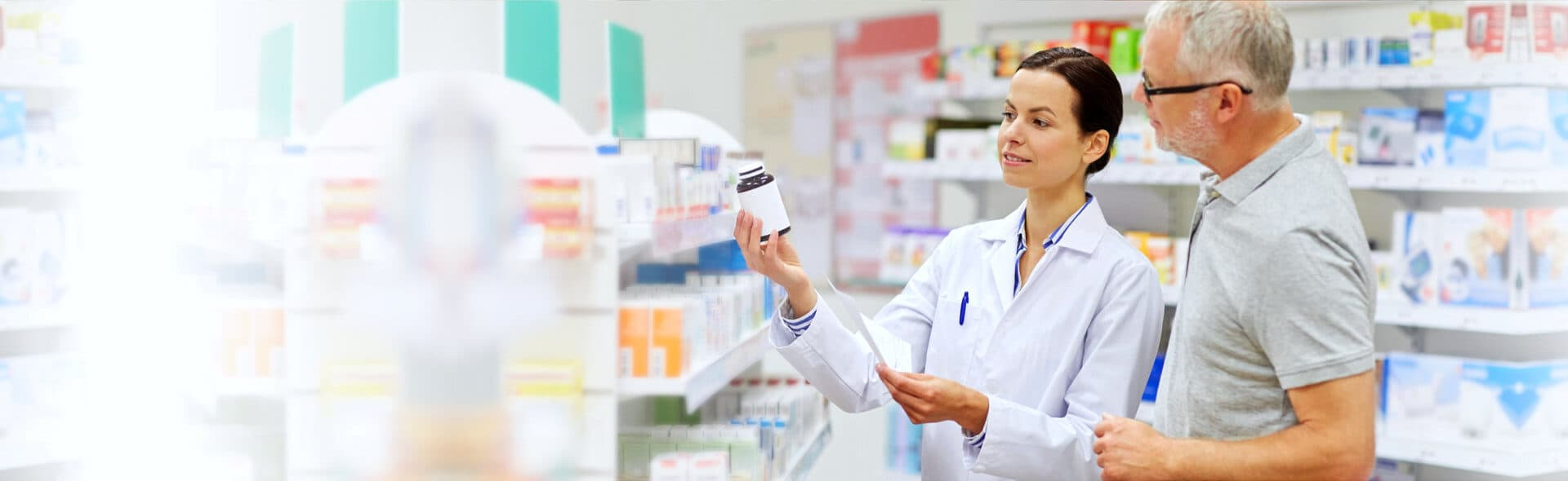 pharmacist discussing the product to senior man