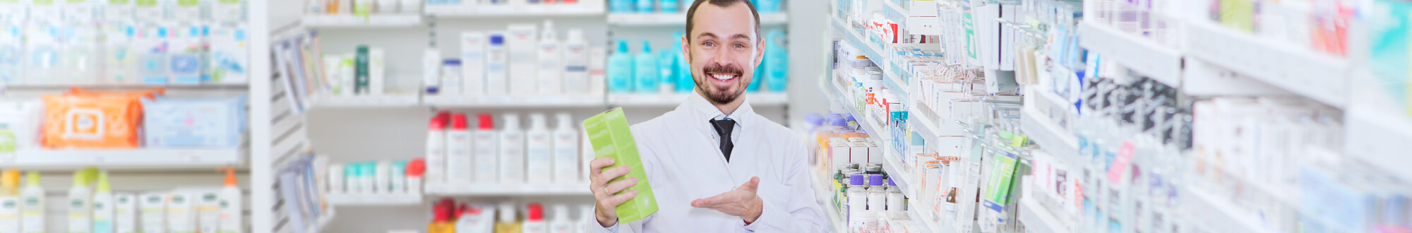 pharmacist smiling and holding a product